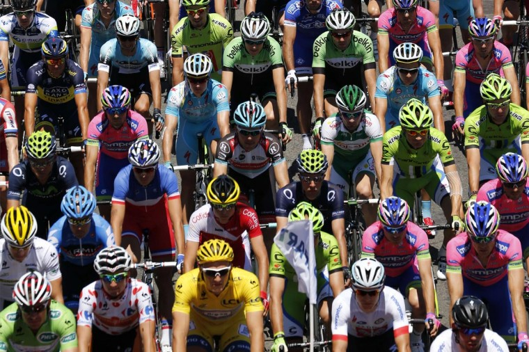 The pack rides during the 156 km second stage of the 100th edition of the Tour de France cycling race on June 30, 2013 between Bastia and Ajaccio, on the French Mediterranean Island of Corsica. (Joel Saget/AFP/Getty Images)