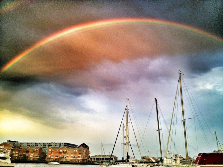A rainbow shines over Baltimore's harbor in this photo taken from the Anchorage Marina in Baltimore, on Fri., June 28, 2013. (Photo by Ethan Haskel, submitted on Twitter by @cormend1)