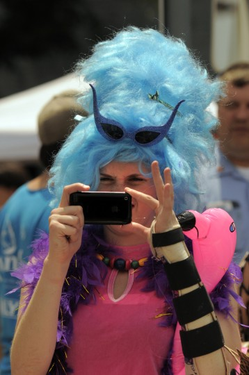 Suzanna Curtis, visiting from Chicago specifically for Honfest, takes a picture of what those involved call the world's largest crab cake at the annual 2009 Honfest in the Hampden community. (Karl Merton Ferron/Baltimore Sun)