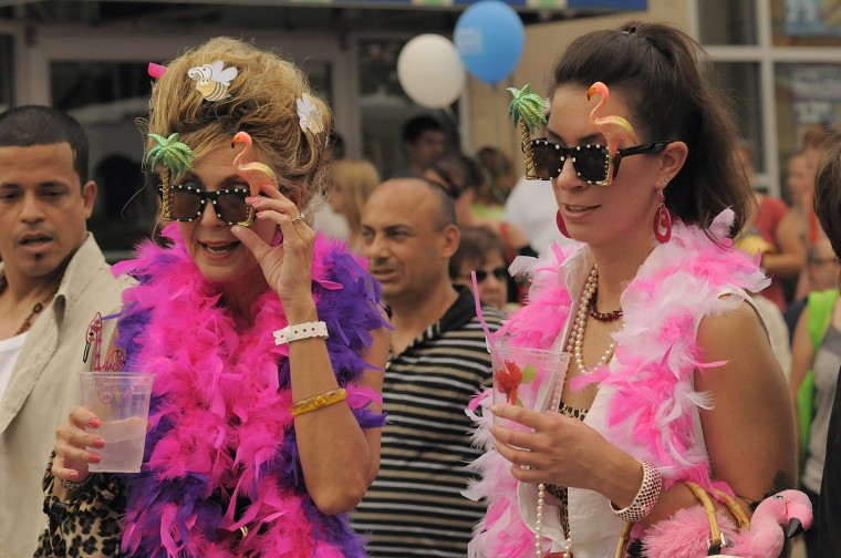Debbie Holub, left, and Juli Williams, both of Pasadena, Md. are decked out in attire as they look at the surroundings at the annual 2009 Honfest in the Hampden community. (Karl Merton Ferron/Baltimore Sun)