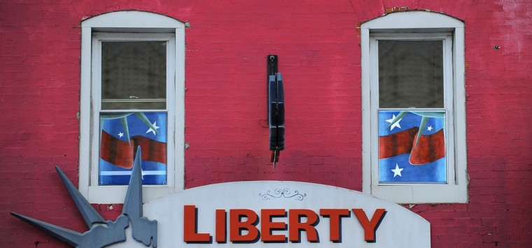 Liberty Income Tax on Eastern Ave. in Highlandtown sports its own patriotic painted screens. (Erin Kirkland/Baltimore Sun)