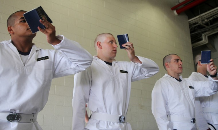 Plebes study their Reef Points, the Navy Academy's manual covering all rules and regulations at Induction Day. (Erin Kirkland/Baltimore Sun)