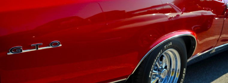 A 1967 GTO reflects the 1966 Corvette in it's beautiful red paint in the early morning sun. (Gene Sweeney Jr./Baltimore Sun)