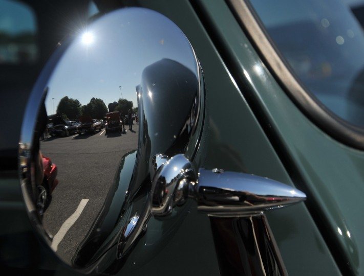 Some of the cars on display are reflected in this side mirror on a 1960 Chevrolet. (Gene Sweeney Jr./Baltimore Sun)