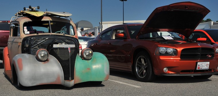 A 1939 Chevrolet that is in need of some continuing work sits next to a sparkling 2010 Charger R/T at last Saturday's Coffee & Cars gathering. (Gene Sweeney Jr./Baltimore Sun)