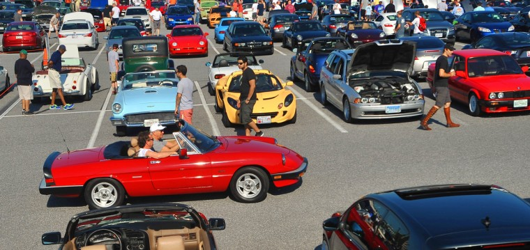 An Alpha Spider cruises the aisles of the Coffee & Cars gathering at Hunt Valley Towne Centre. Early Saturday mornings car enthusiasts begin their weekend gathering to drink coffee and show off their cars. (Gene Sweeney Jr./Baltimore Sun)