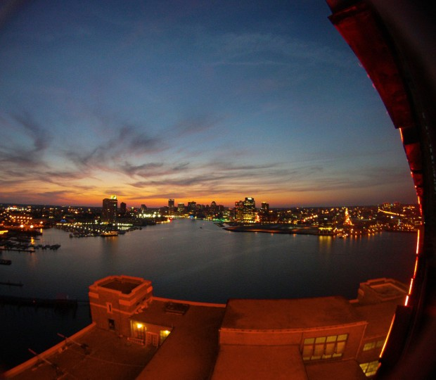 The Domino Sugars sign casts a red glow on the rooftop of the refinery in this view of the Inner Harbor taken with a fisheye lens. The iconic neon sign, 120 feet by 70 feet, takes 15 minutes to illuminate. (Karl Merton Ferron/Baltimore Sun Photo)