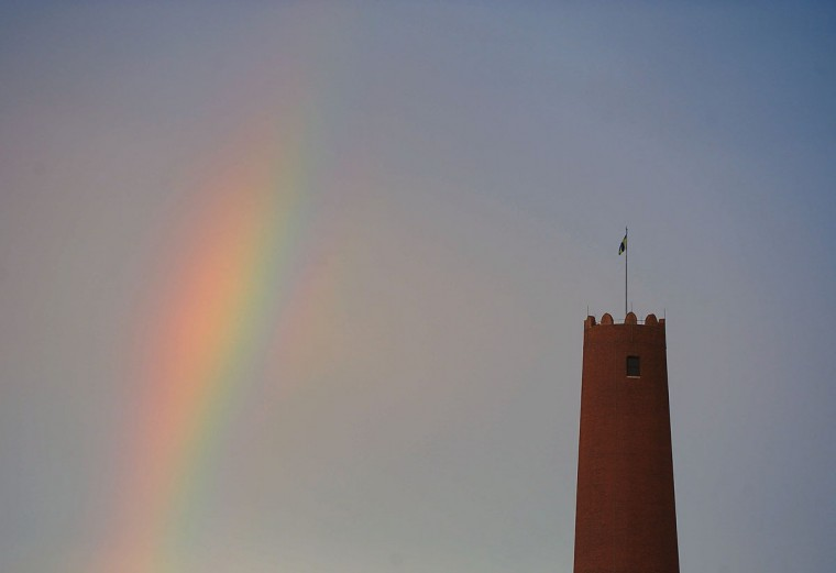 A portion of a rainbow rises behind the Shot Tower in Baltimore, Friday, Jun. 28, 2013. (Karl Merton Ferron/Baltimore Sun Photo)