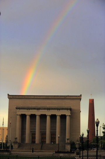 A portion of a rainbow rises above the War Memorial Plaza and Shot Tower in Baltimore on Friday, Jun. 28, 2013. (Karl Merton Ferron/Baltimore Sun Photo)