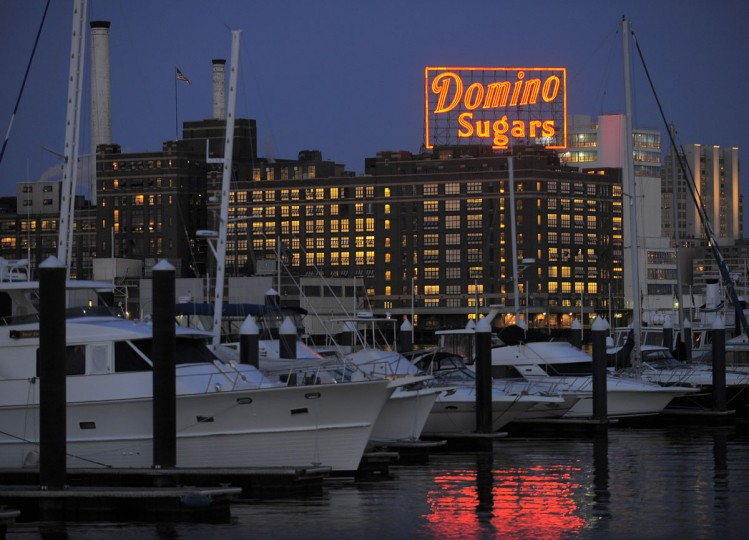 A view of the Domino Sugars refinery shows the sign at dusk. (Karl Merton/Baltimore Sun Photo)