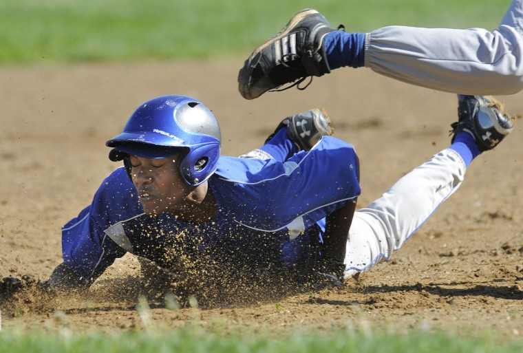 Carver #6 Davon Johnson dives safely head first into third base in a game against Forest Park. (Lloyd Fox/BSMG)
