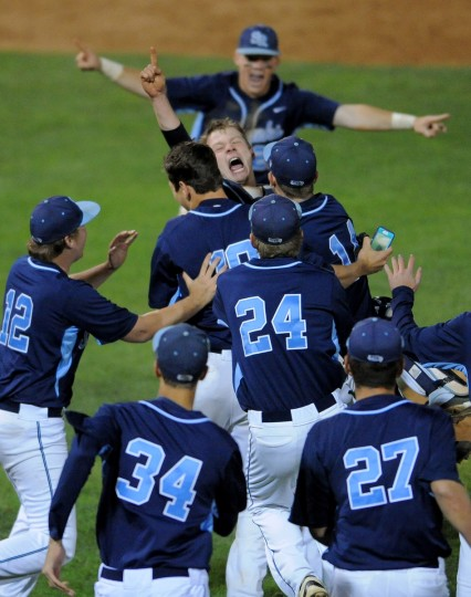 South Rivers' catcher #10 Jake Gratz (face towards camera) and others celebrate their 6-0 win over Catonsville to take the class 4A baseball final. (Gene Sweeney Jr./BSMG)