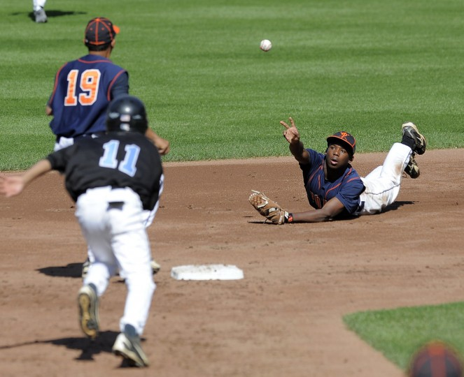 Poly High second baseman #2 Marquise Coleman makes a diving catch and then gets the double play on Digital Harbor's #11 Keyon Bennett to end the first inning. (Lloyd Fox/BSMG)