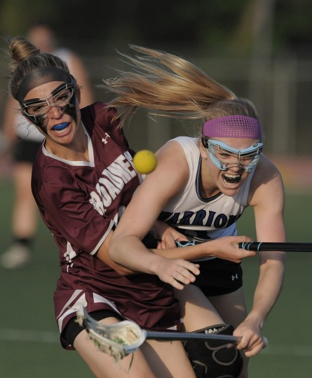 Broadneck High's Michaela Cassidy, left, collides with and knocks the ball loose from Sherwood High's Rebecca Dunwoody. Broadneck easily handled Sherwood, 21-5, to take the girls 4a-3A championship. (Gene Sweeney Jr./BSMG)