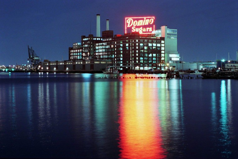 A nighttime view of the Domino Sugars sign, taken in 1996. (Andre F. Chung/Baltimore Sun File Photo)