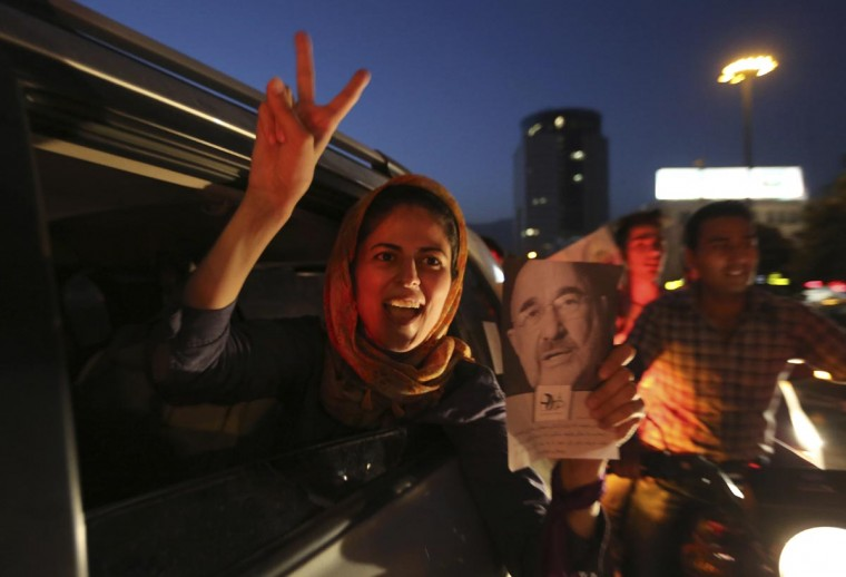 An Iranian woman celebrates the victory of moderate presidential candidate Hassan Rowhani in the presidential elections at Vanak Square, in northern Tehran, on June 15, 2013. (Atta Kenare/AFP/Getty Images)