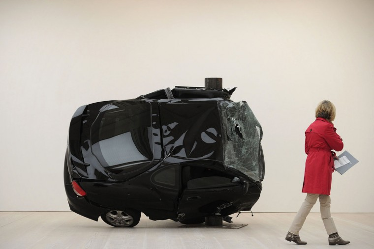 May 26, 2011: A visitor walks past part of an installation by German artist Dirk Skreber entitled 'Untitled (Crash 1) and Untiteld (Crash 2)' at the Saatchi Gallery in central London, which form part of 'The Shape of Things To Come: New Sculpture' exhibition. (Carl Court/AFP/Getty Images)