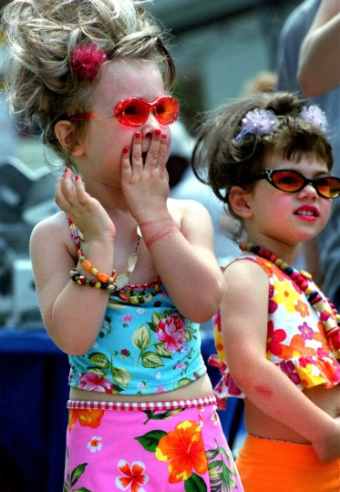 "The10th annual Hon Fest in Hampden, celebrates ""all things Bawlmer."" Riley Beveridge (left) spent the day dishing with best friend Madeline Komons (right, both three years old) about all the other Hons at the festival. (Monica Lopossay/Baltimore Sun)"