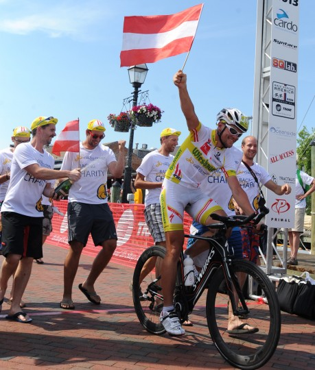 Austrian Christoph Strasser celebrates with his crew as he crosses the finish line in Annapolis in his record setting Race Across America. Strasser won the bicycle race from Oceanside, CA to Annapolis, MD, completing the 2989 mile distance in 7 days, 22 hours, and 11 minutes. (Jerry Jackson/Baltimore Sun)