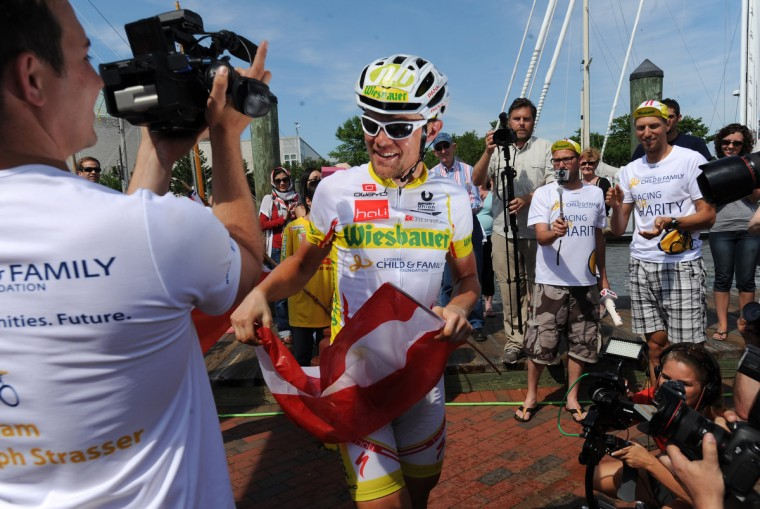 Christoph Strasser jokes with his team after completing the Race Across America. (Jerry Jackson/Baltimore Sun)