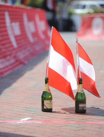 Austrian flags in champagne bottles sit at the finish line in Annapolis after Christoph Strasser completed his record setting Race Across America. (Jerry Jackson/Baltimore)