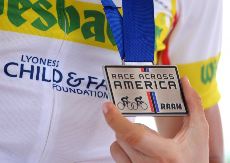 Christoph Strasser shows of his RAAM finisher's medal after his record setting Race Across America. All finisher receive the same medal. The only prize for finishing first is bragging rights. (Jerry Jackson/Baltimore Sun)