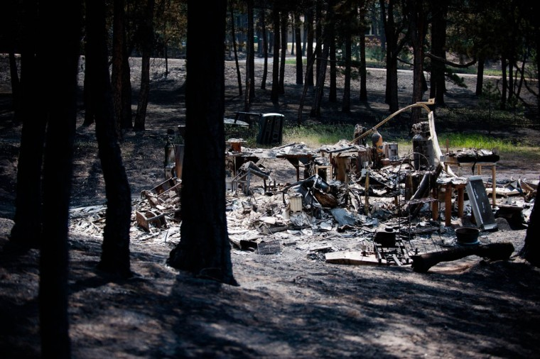 A detached garage smolders after being burned by the quickly advancing Black Forest fire in Colorado Springs Colorado, Thursday, June 13, 2013. (Michael Ciaglo/Colorado Springs Gazette/MCT Photo)