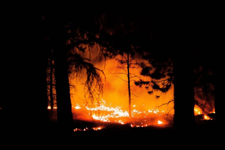 Flames continue to burn through the night early Thursday morning, June 13, 2013, as crews work to contain the Black Forest fire in Colorado Springs, Colorado. (Michael Ciaglo/Colorado Springs Gazette/MCT Photo)