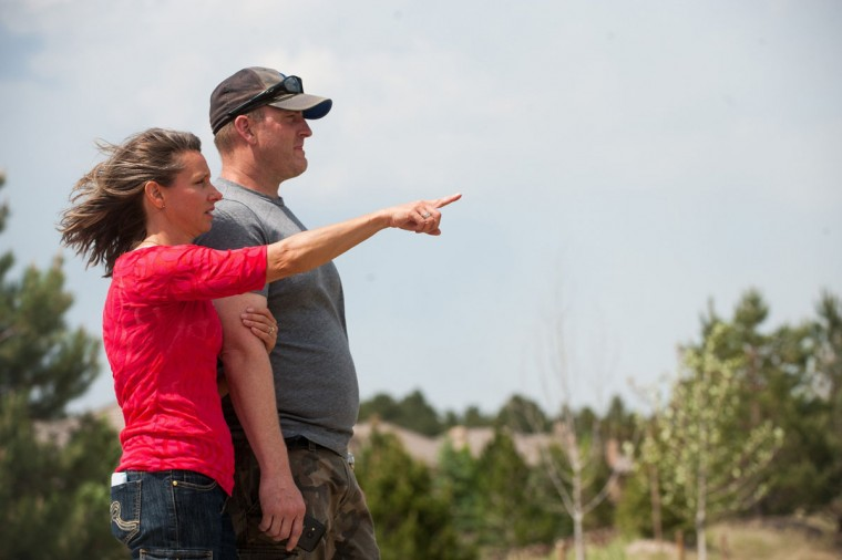 Suzanne and Matt Dubois watch flames from the Black Forest fire creep closer to the Flying Horse neighborhood on Thursday, June 13, 2013, in Colorado Springs, Colorado. (Michael Ciaglo/Colorado Springs Gazette/MCT Photo)