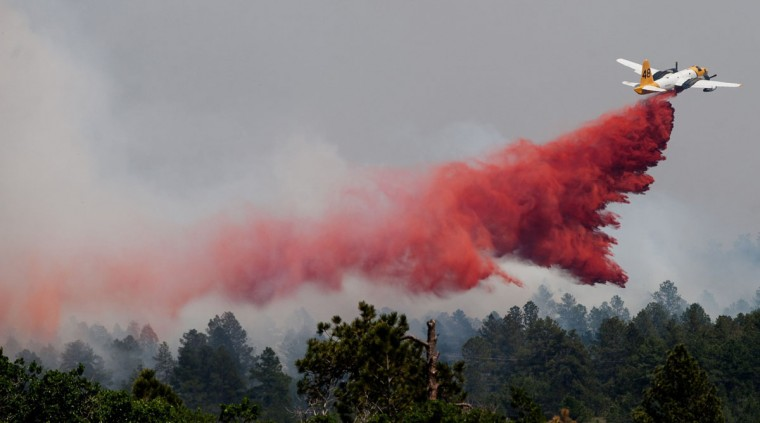 A slurry bomber makes a pass over the Black Forest fire, Thursday, June 13, 2013, in Colorado Springs, Colorado. (Michael Ciaglo/Colorado Springs Gazette/MCT Photo)