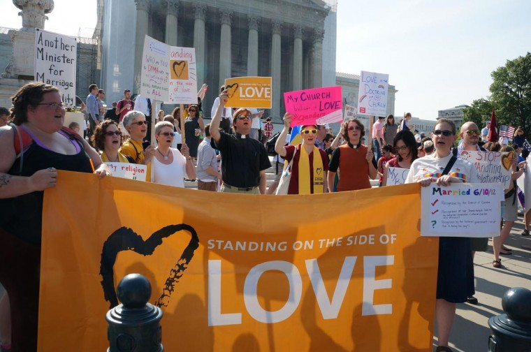 Demonstrators gather outside the U.S. Supreme Court on the day that the Court struck down the Defense of Marriage Act, Wednesday, June 26, 2013, in Washington, D.C. (Tish Wells/MCT)