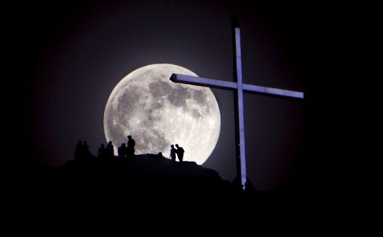 "A ""supermoon"" rises over Table Rock and lighted cross in Boise, Idaho on Saturday, June 22, 2013. (Kyle Green/Idaho Statesman)"
