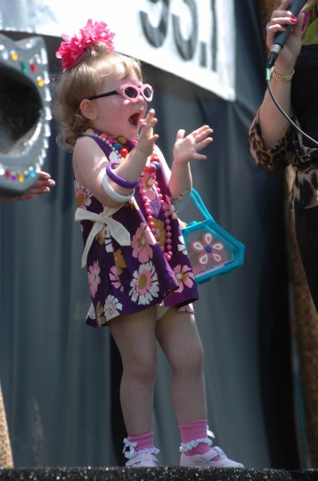"Three year old Jocelyn Jacobsen was overjoyed with the crowd and her 2nd place win in the ""lil Hon"" contest at the 2004 Hampden Honfest. (Monica Lopossay /Baltimore Sun)"