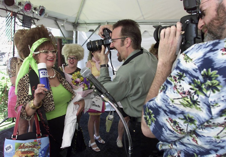 "Jackie Garcia aka ""Madge Poopa"" attains instant celebrity status after winning the ""Honfest 2002"" competition at Cafe Hon in Hampden. (Matt Houston/for The Sun)"