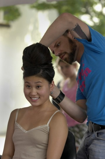 Jackie Gong, 21, Towson, has her hair styled into a beehive in the Glamour Lounge by Maurice Lease. Gong and friends are taking in Honfest '08 on the Avenue in Hampden. (Kim Hairston/Baltimore Sun)