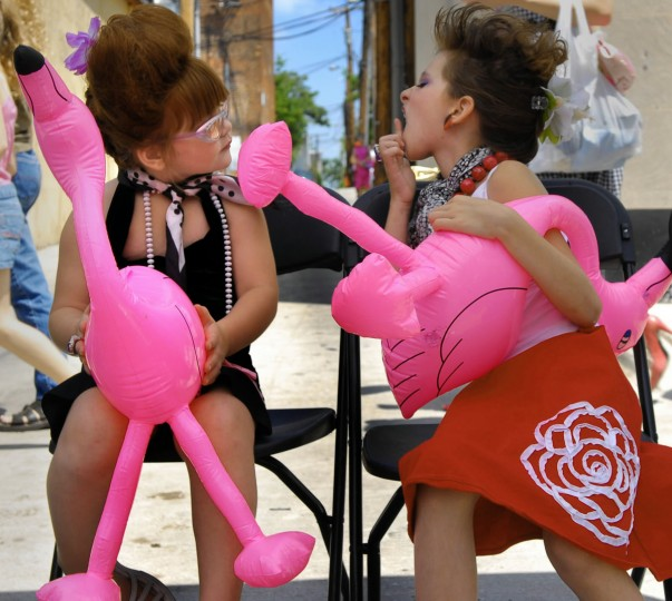 Carmyn Santoro, 4, left, and her cousin Halle Love, 6, right, take a break from their Lil' Miss Hon Contest as part of HonFest. Carmyn won second place, and Carmyn's sister was the winner for the Miss Honnett and their grandmother was a finalist for the Best Hon Contest. (Chiaki Kawajiri/Baltimore Sun)