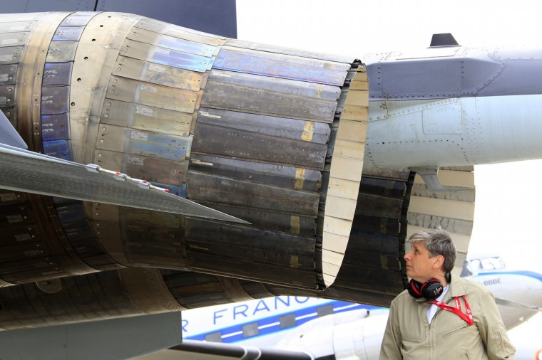 An engineer checks specials vectored thrust jet engines of a Sukhoi Su-35 fighter after a flying display, two days before the Paris Air Show, at the Le Bourget airport near Paris, June 15, 2013. (Pascal Rossignol/Reuters)