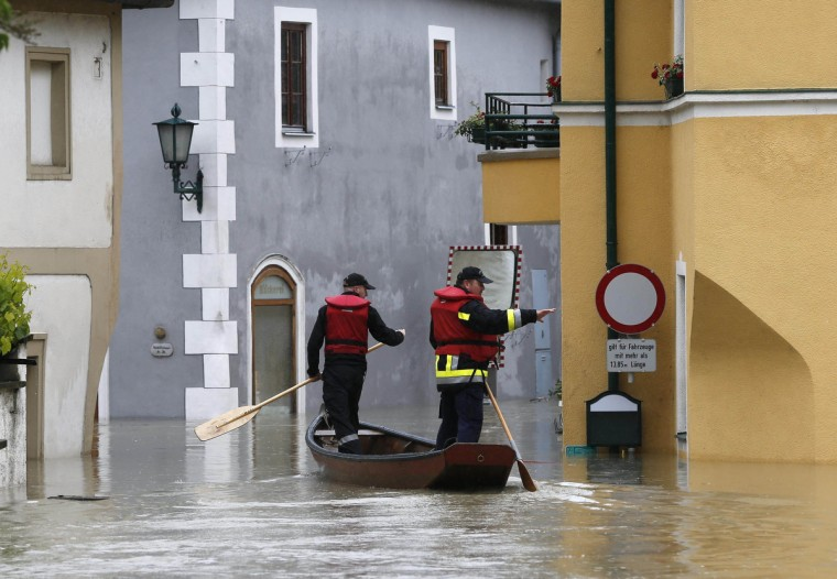 Members of the emergency services travel by boat along a flooded street in the centre of the Austrian village of Emmersdorf, about 100 km (62 miles) west of Vienna June 3, 2013. Torrential rain in Tyrol, Salzburg, Upper and Lower Austria caused heavy flooding over the weekend, forcing people to evacuate their homes. (Leonhard Foeger/Reuters)