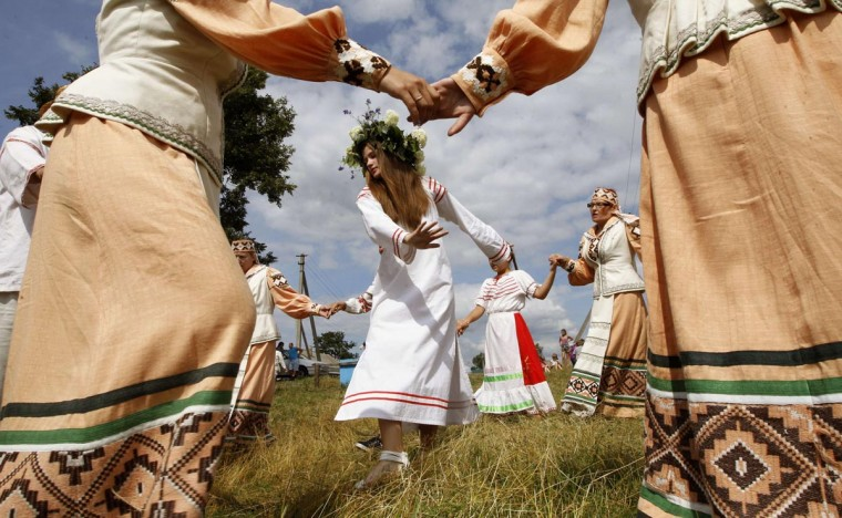 Belarusian women take part in the Rusalle festival (the holiday of mermaids) in the village of Sosny, about 124 miles) south of Minsk, June 30, 2013. (Vasily Fedosenko/Reuters)