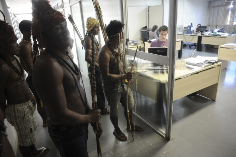 Munduruku Indians stand guard at the offices of the Brazil's Indian affairs bureau (FUNAI) headquarters after storming the building in Brasilia. The Indians from the Amazon Basin are demonstrating against violations of indigenous rights and calling for the suspension of the construction of the Belo Monte hydroelectric plant on the Xingu, Teles Pires and Tapajos rivers, a huge project aimed at feeding Brazil's fast-growing demand for electricity. (Lunae Parracho/Reuters)