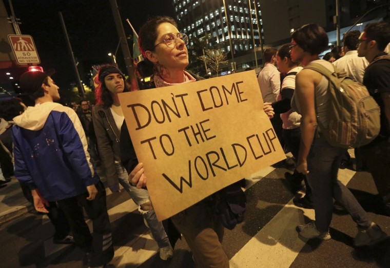 A demonstrator holds a sign during one of the many protests around Brazil's major cities in Sao Paulo June 17, 2013.(Nacho Doce/Reuters)