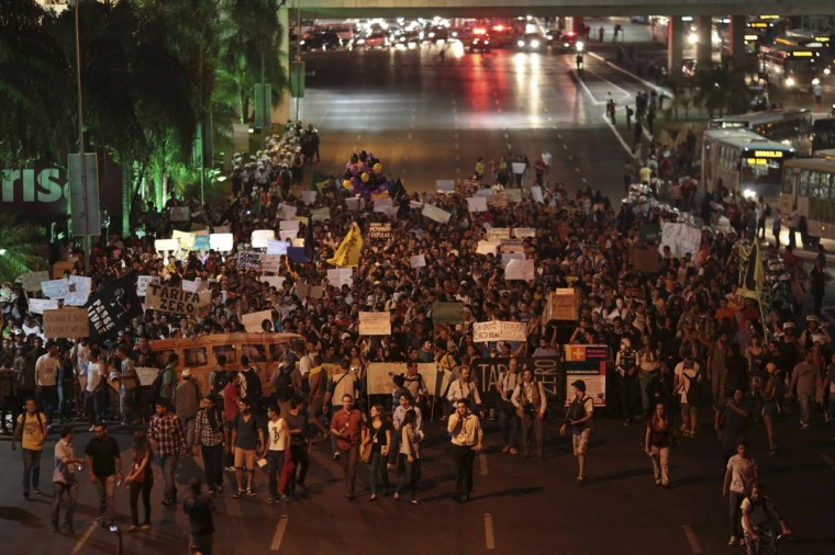 "Students,and members of the ""Free Pass"" movement walk down a street during a protest demanding improvements be made to the public transport system, at the bus station in the centre of Brasilia June 19, 2013. (Christophe Simon/AFP/Getty Images)"