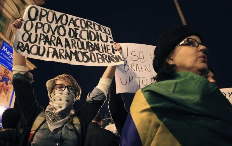 Demonstrators hold up signs and yell anti-government slogans during one of the many protests around Brazil's major cities outside the City Hall in Porto Alegre June 17, 2013. (Gustavo Vara/Reuters)