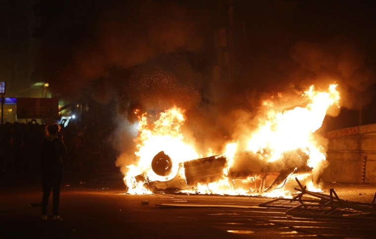 A car burns during a protest in downtown Rio de Janeiro June 17, 2013. (Sergio Moraes/Reuters)
