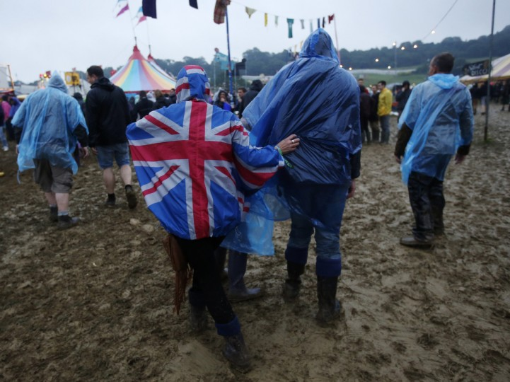 Festival goers negotiate muddy fields after heavy rainfall on the second day of Glastonbury music festival at Worthy Farm in Somerset, June 27, 2013. (Olivia Harris/Reuters)