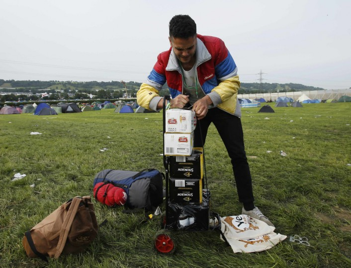 Jimmy Dunne, 24, repacks his crates of beer as he arrives at the campsite on the second day of Glastonbury music festival at Worthy Farm in Somerset, June 27, 2013. (Olivia Harris/Reuters)