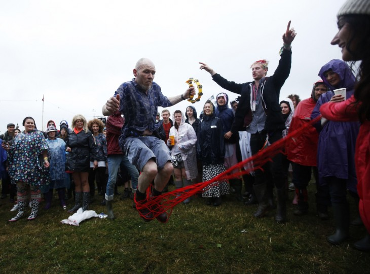 Musician Dan Druy comes off stage to skip rope with the crowd on the second day of Glastonbury music festival at Worthy Farm in Somerset, June 27, 2013. (Olivia Harris/Reuters)