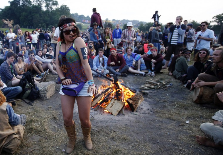 A festival goer dances to the drums at the Stone Circle on the first day of Glastonbury music festival at Worthy Farm in Somerset, June 26, 2013. (Olivia Harris/Reuters)