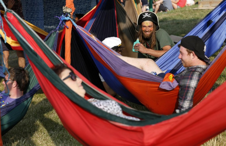 A festival goer dressed as a pirate relaxes in a hammock on the first day of Glastonbury music festival at Worthy Farm in Somerset, June 26, 2013. (Olivia Harris/Reuters)