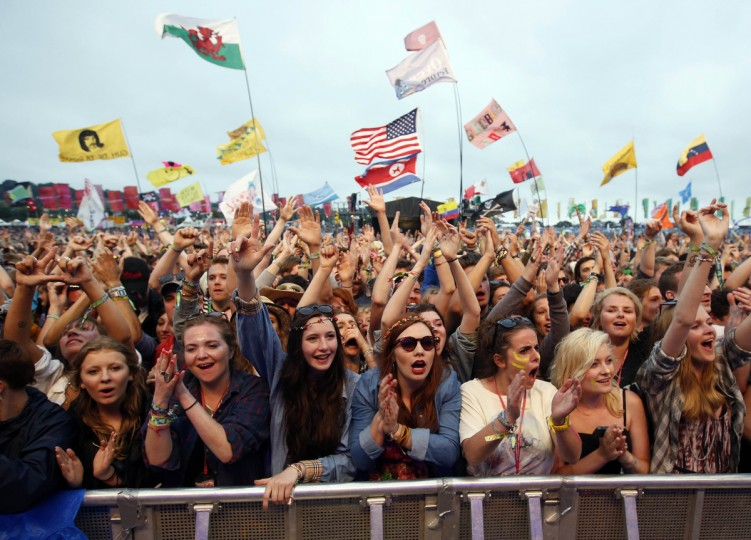 Festival goers cheer Alt J performing on the Other Stage on the third day of Glastonbury music festival at Worthy Farm in Somerset, June 28, 2013. (Olivia Harris/Reuters)